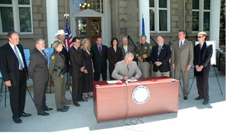 http://stopthedrugwar.org/files/dumb-bill-signing.jpg